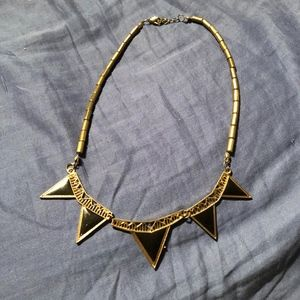 gold and black detailed necklace